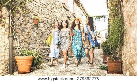 Multiracial Millennial Girlfriends Walking In Old Town Tour - Happy Girl Best Friends Having Fun Aro