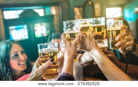Friends Group Drinking And Toasting Beer At Brewery Bar Restaurant - Friendship Concept With Young M