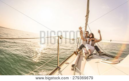 Young Lovers Couple On Sail Boat With Champagne At Sunset - Exclusive Luxury Concept With Rich Mille