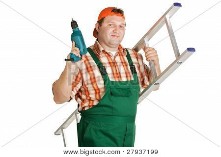 Worker, Dressed In Overalls With A Drill Aluminum Ladder