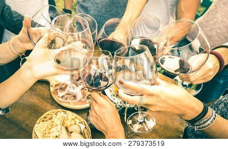Friend Hands Toasting Red Wine While Having Fun Outside Cheering With Winetasting - Young People Enj