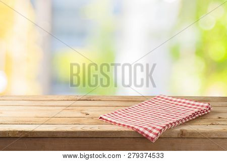 Empty Wooden Table With Table Cloth Over Abstract Bokeh Background. Mock Up For Display Or Montage P