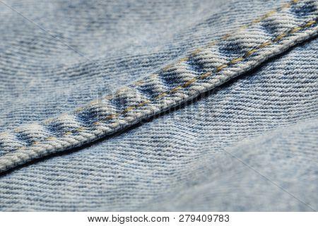 Blue Jeans Fabric Macro Seam Pattern Blurred Background. Denim Jeans Texture.  Blue Jeans Texture Fo