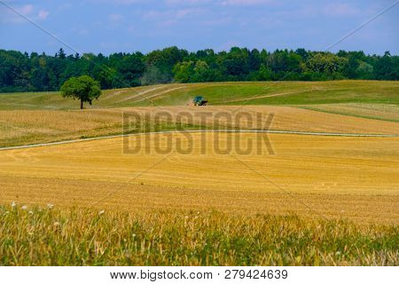 Tractor working at agricultural field in Switzerland