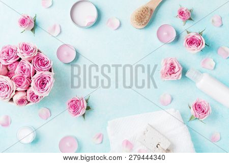 Aromatherapy, Spa, Beauty Background With Roses Flowers, Cosmetics And Candles On Blue Table. Flat L