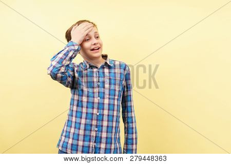 Facepalm, Failure, Shame. Awkward Embarrassed Boy Covering Forehead With Hand Over Yellow Background