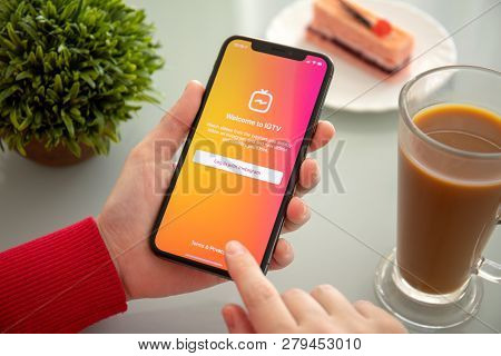 Alushta, Russia - November 6, 2018: Woman Hand Holding Iphone X With Social Networking Service Igtv