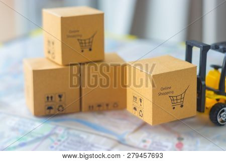 Mini Forklift Truck Load Cardboard Box With Text Online Shopping And Symbols On Street Map. Logistic