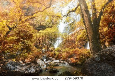 Amazing In Nature, Beautiful Waterfall At Colorful Autumn Forest In Fall Season - Image