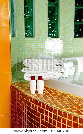 Towel, shampoo and gel in a bathroom