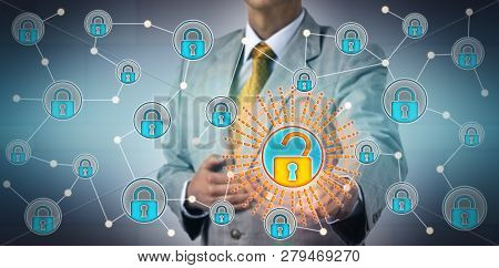 Torso Of Unrecognizable Manager Opening One Virtual Lock In A Network. Concept For Authenticated And