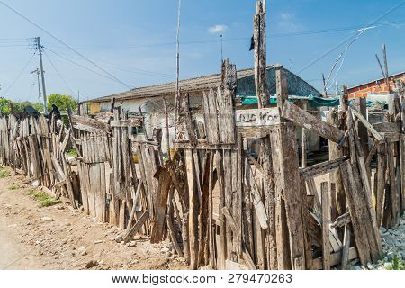 Wooden fence in Bocachica village on Tierrabomba island near Cartagena, Colombia poster