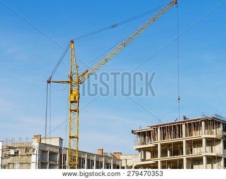 Crane. Crane Over Construction Site. Construction Crane Near Building.