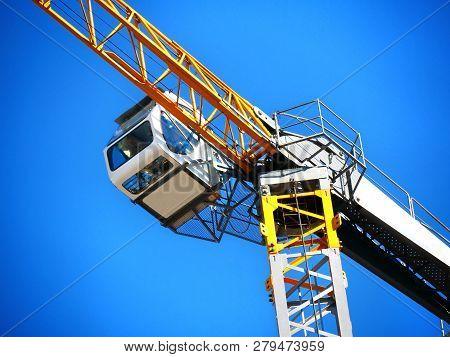 Crane. Close-up Of A Construction Crane.construction Crane Near The Building Under Construction.