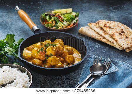 Meatballs In Fragrant Indian Curry Sauce Served With Pilau Rice And Naan Bread, Selective Focus