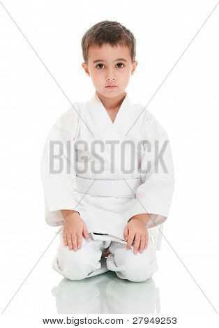 Karate Boy Sitting In White Kimono