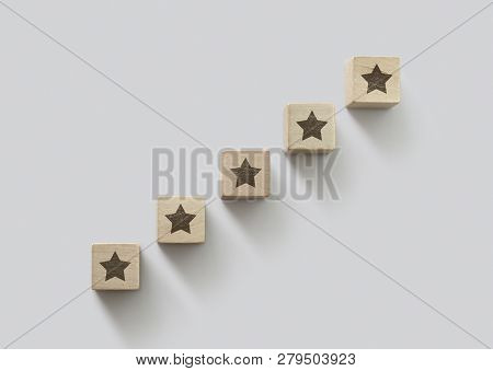 Wooden Blocks Arranged In Stair Shape With The Five Star Symbol. The Best Rating, The Best Ranking,