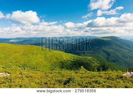 Beautiful Landscape Of Carpathian Mountains. Grassy Alpine Meadows, Deep Valleys And Distant Foreste