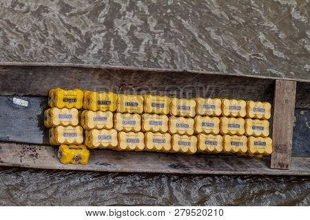 Napo, Peru - July 15, 2015: Beer Cans In A Canoe On A River Napo, Peru