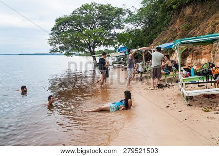 Manaus, Brazil - July 25, 2015: People At Praia Da Ponta Negra Beach During High Water Level.
