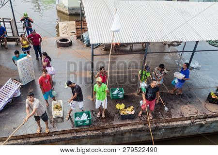Juruti, Brazil - June 28, 2015: Sellers Use A Long Stick To Deliver The Goods To Passengers Of A Riv