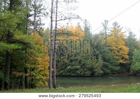 The Pond In The Colorful Autumn Forest