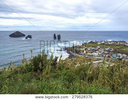 Aerial View Of The Beautiful Mosteiros Village With Dark Sand Beach With Volcanic Rock Cliffs And St