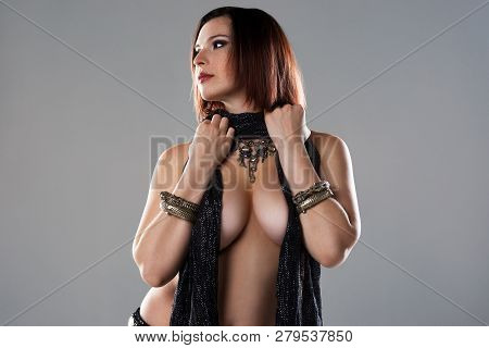 Sexy Women Performs Belly Dance In Ethnic Dress On Gray Background