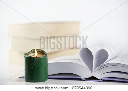 Heart Shape From Paper And Burning Green Candle Against White Background. Love For The Books