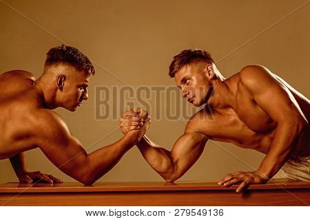 Strength and endurance. Twins men competing till victory. Twins competitors arm wrestling. Men competitors try to win victory or revenge. Strength skills. Revenge in sport. poster