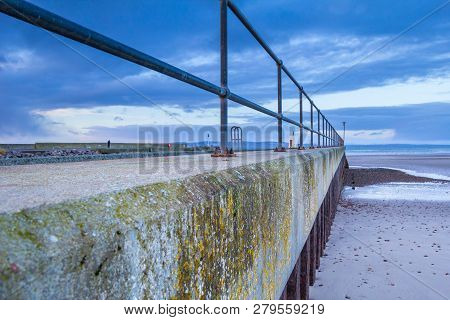 Seaside Concrete Pier And Beach, Nairn, Scotland