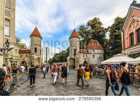 Tallinn, Estonia - September 10 2018: Tourists Leave The Medieval Old Town Of Tallinn Estonia Throug