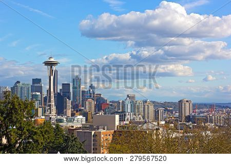 poster of Urban Seattle panorama and distinctive peak of Mount Rainier above the clouds on horizon. Scenic view on urban skyline from a high elevation point in Seattle, USA.