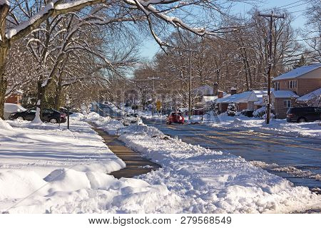 A Neighborhood Road After A Heavy Snowstorm In Falls Church, Virginia, Usa. Layer Of Snow On Tree Br