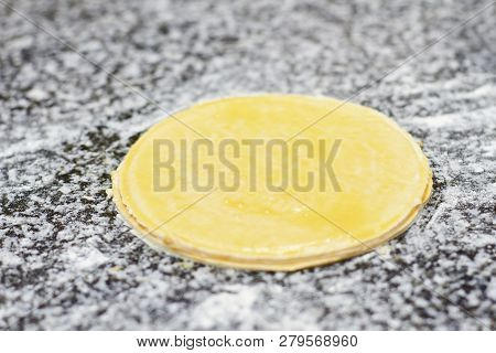 Close Up Greased Round Dough On Table. Greased Round Basis.