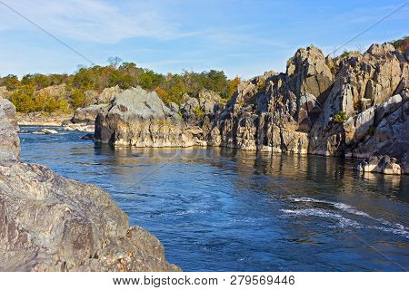 Mountainous Banks Of Potomac River On Sunny Day In Autumn, Virginia, Usa. A Scenic River Bend In Gre