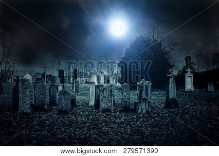 Tombstone On A Creepy Graveyard At Night