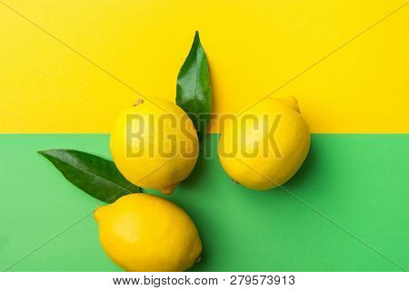 Bright Ripe Organic Lemons On Contrast Duotone Background From Combination Of Yellow Green Colors. C