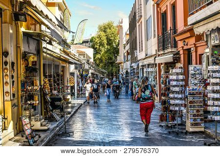 Athens, Greece - September 22 2018: Tourists Walk The Streets Lined With Souvenir Shops And Outdoor