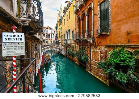 Venice, Italy - September 18 2018: A Gondolier Waits For Tourist Customers At A Gondola Service Poin