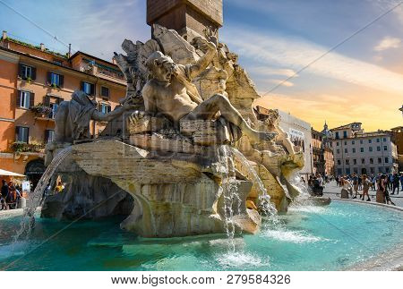 Rome, Italy - September 30 2018: Tourists Visit The Fountain Of The Four Rivers By Bernini In The Pi