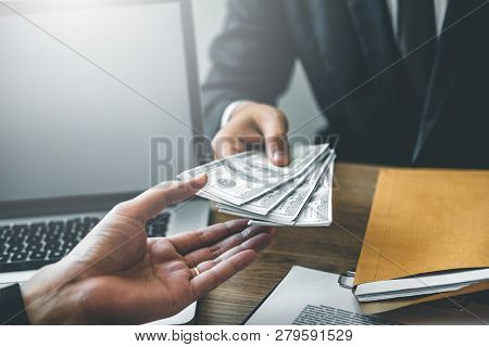 Corruption Concept,business Man Passing Money Dollar Bills Corruption Bribery To Businessman Manager