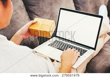 Young Man Startup Entrepreneur Small Business Owner Working With Laptop Blank Screen At Home,online