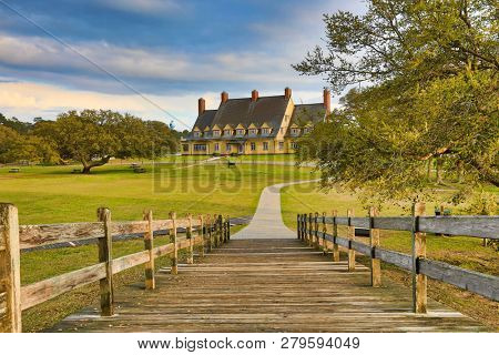 The footbridge in Heritage Park in Corolla on the Outer Banks in North Carolina is a historic landmark.  It connects the walkway to the Whalehead Club.  Currituck is on the sound.