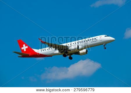 Zurich, Switzerland - July 19, 2018: Helvetic Swiss airlines airplane preparing for landing at day time in international airport