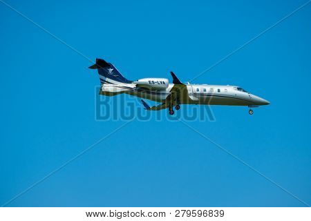 Zurich, Switzerland - July 19, 2018: Small private jet airplane preparing for landing at day time in international airport