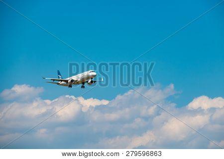 Zurich, Switzerland - July 19, 2018: Montenegro airlines airplane preparing for landing at day time in international airport