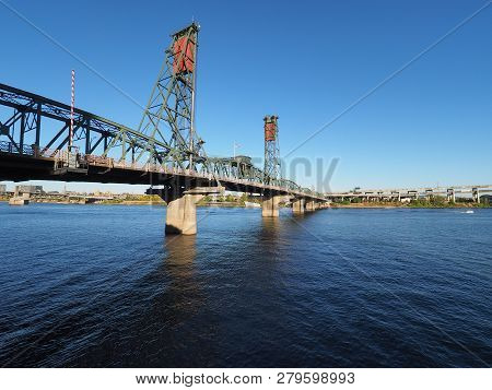 The Hawthorne Bridge Over The Willamette River In Portland, Oregon, On A Clear, Cloudless Autumn Aft