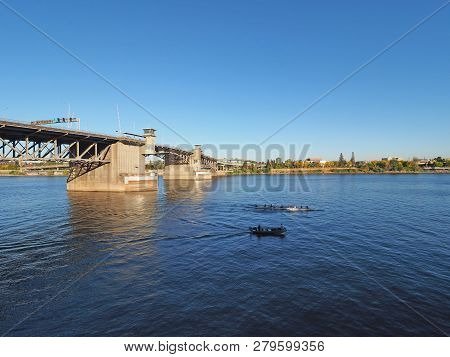 The Morrison Bridge Over The Willamette River In Portland, Oregon, On A Clear And Cloudless Autumn A