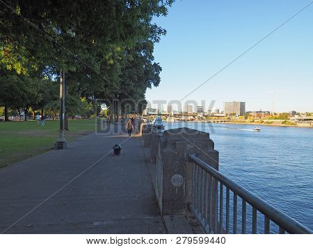 Waterfront Park And The Willamette River In Portland, Oregon, On A Clear And Cloudless Autumn Aftern